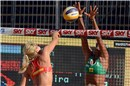 Erika Fabjan (SLO) is blocked by Priscilla (BRA) during Qualification Tournament