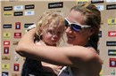 Kerri Walsh (USA) with her older kid Joey