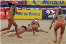 Goller (GER) digs for the Mikasa during the match against Larissa/Juliana (BRA)