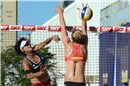 Xi Zhang (CHN) pass over Fendrick\'s (USA) block during a mach of the losers\' bracket