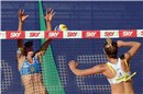 Ross (USA) attacks against Stefanie Schwaigers (AUT) block during a match of the losers\' bracket