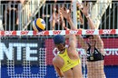 All-American semifinal: Hanson (yellow) attacks against Walsh\'s block