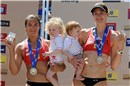 May-Treanor (left) with partner\'s older boy, Joey, and Walsh, holding Sundance in her arms: silver medal in Brasília