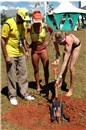 Going Green: Agnelo Queiroz (Governor of the Federal District) and Juliana (BRA) watches Kerri Walsh planting a seedling in Brasília