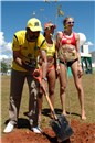 Agnelo Queiroz, Governor of the Federal District, plants a seedling accompanied by Juliana (BRA) and Walsh (USA)