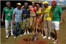 Going Green:  One more symbolic seedling planting to compensate for the greenhouse gases sent out as a result of the tournament
