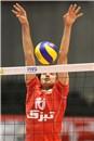 Iran's Amir GHAFOUR blocks the ball