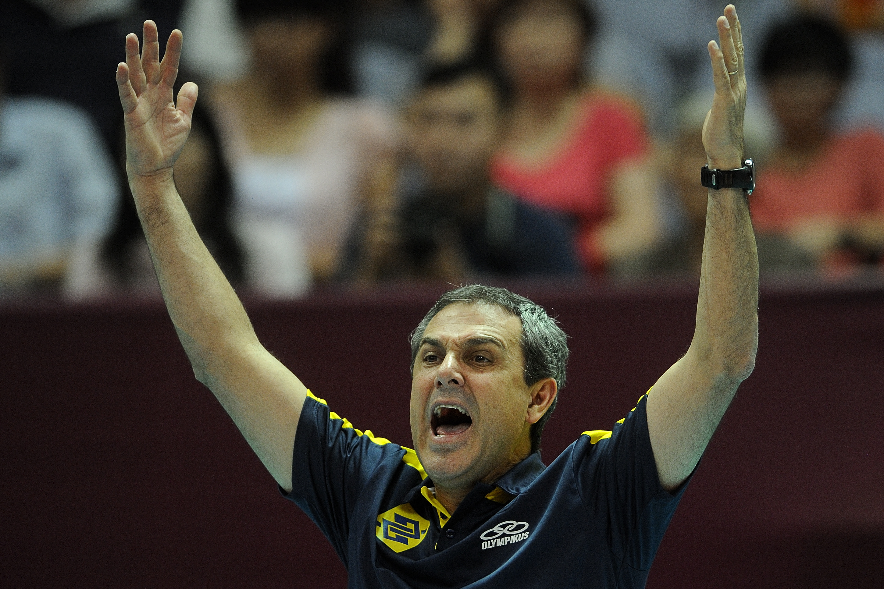 Head coach Jose Roberto Guimaraes raise his arm to hail for the 3-0 victory against Thailand