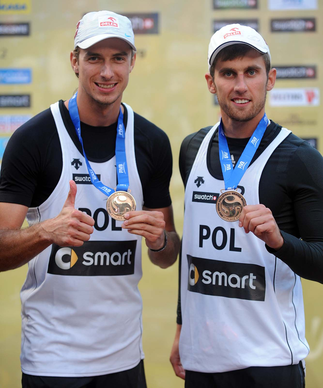 Bronze medalists from Poland Mariusz Prudel (left) and Grzegorz Fijalek