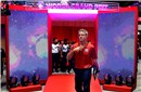 Head coach Karch Kiraly enters the field for the match against Serbia