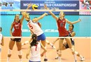 Serbia\'s Krsmanovic Natasa spikes over the USA\'s block
