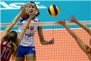 Milena Rasic spiking the Mikasa by the double block