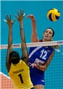 Jelena Nikolic hits the ball along Brazil\'s bloch Fabiana Claudino