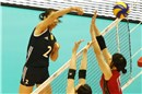 China\'s Zhu Ting spikes against Japan\'s blocks