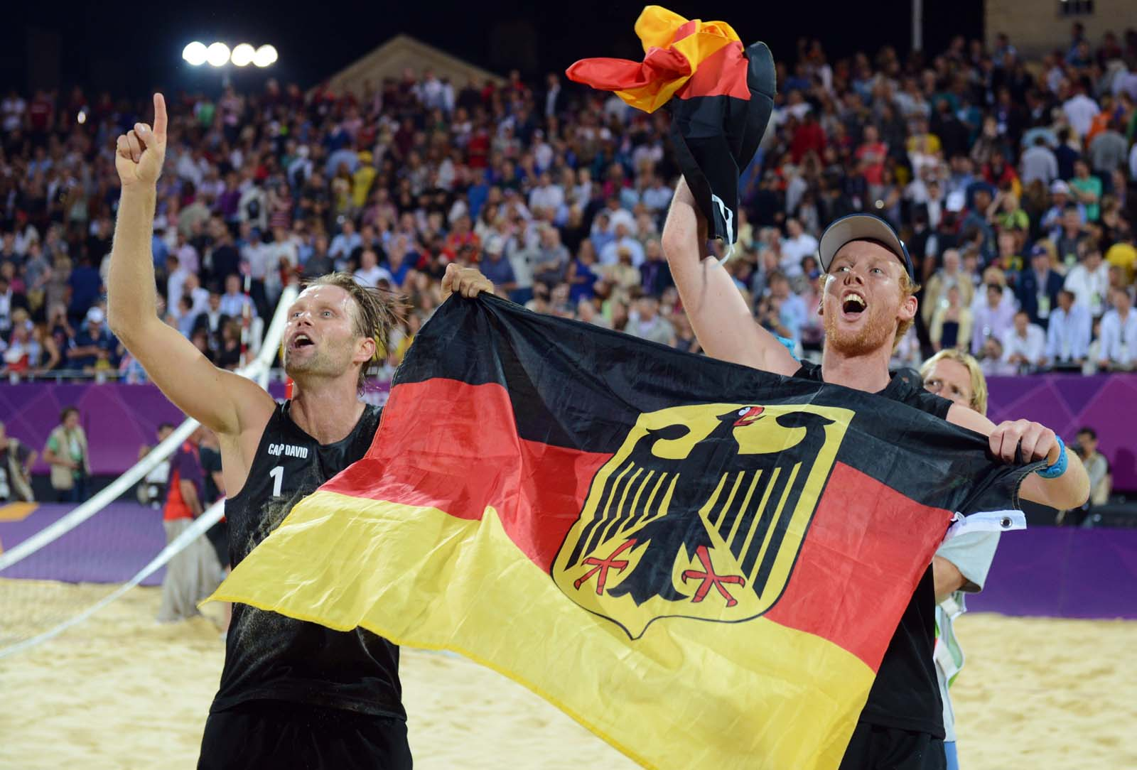 Julius Brink and Jonas Reckermann celebrate winning gold at the London 2012 Olympic Games