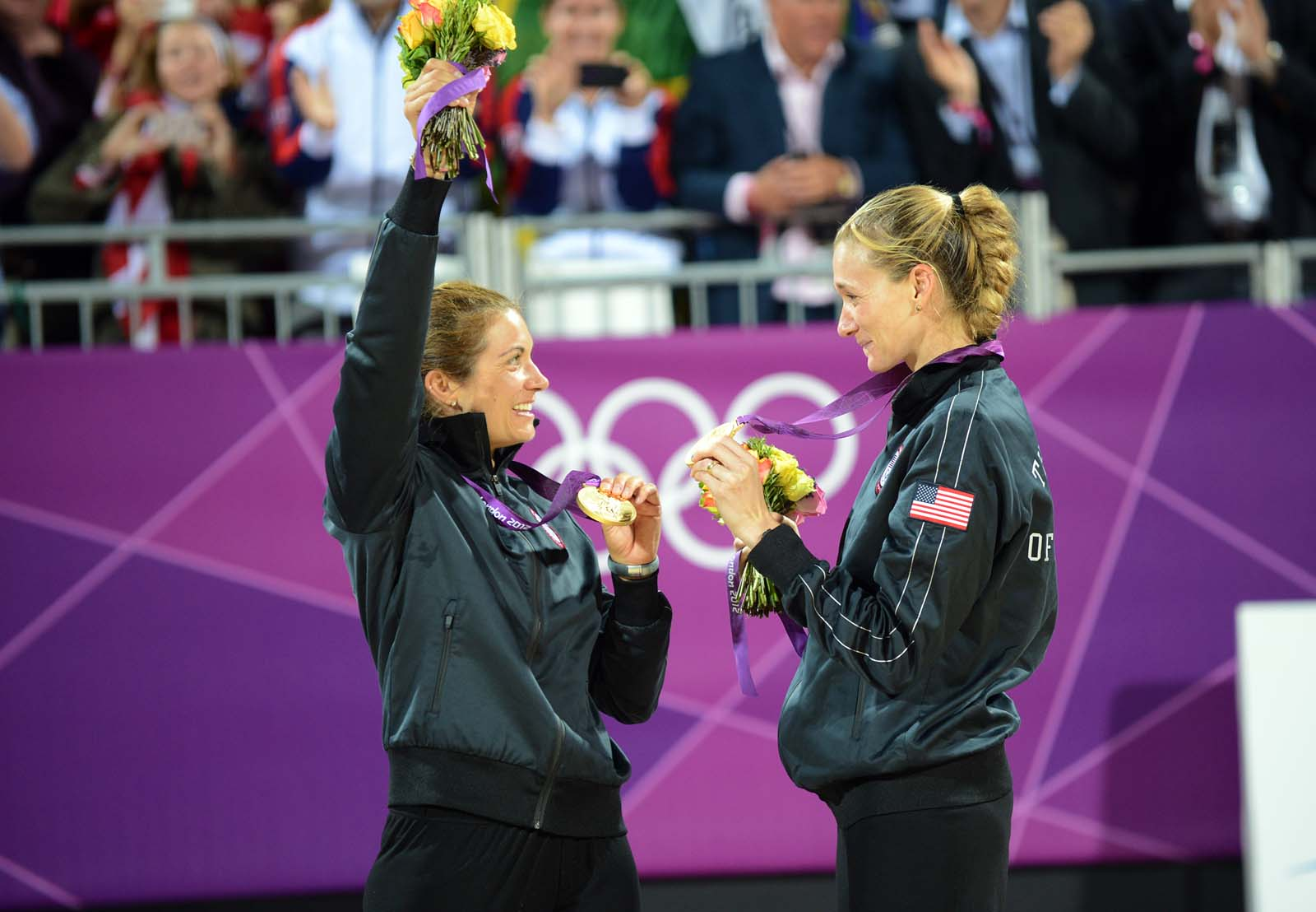 Kerri Walsh Jennings and Misty May Treanor celebrate winning gold at the London Olympics in 2012
