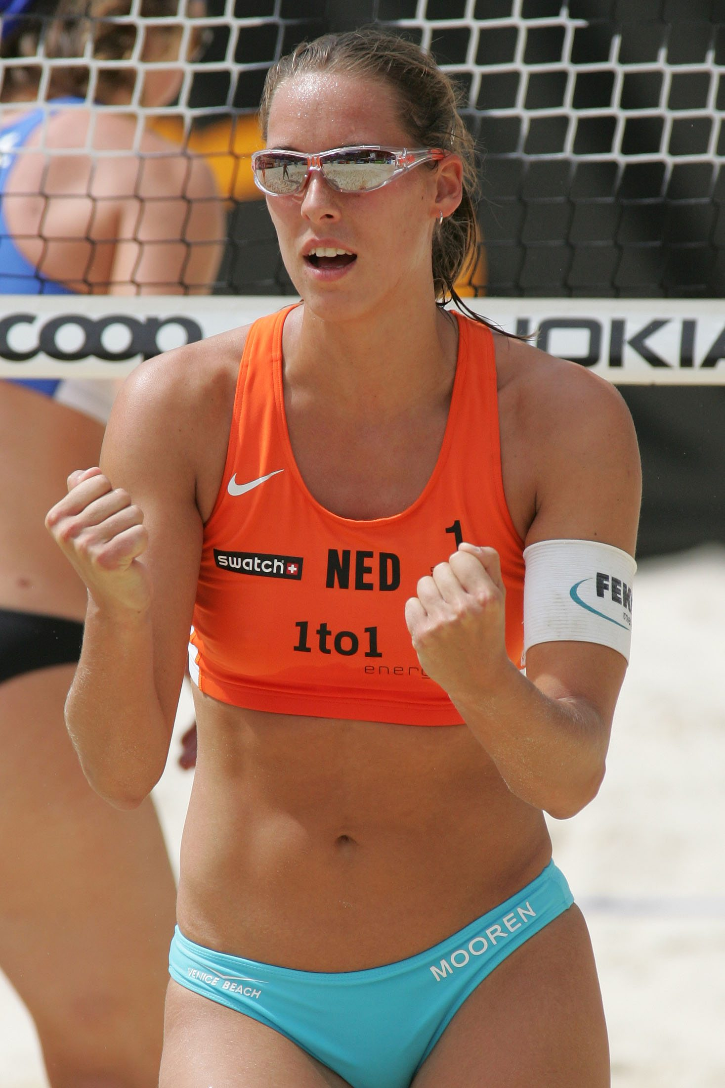 Beach Volleyball action began with the second-ranked American pair of