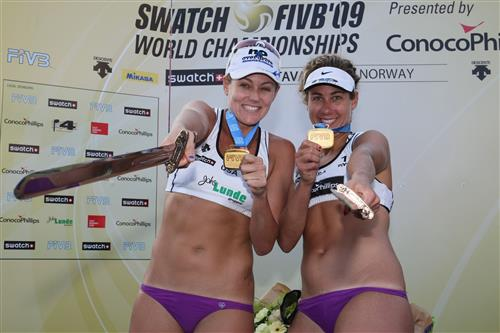 Jen Kessy (left) and April Ross celebrate their gold medal finish Saturday at the 2009 SWATCH FIVB World Championships in Stavanger, Norway