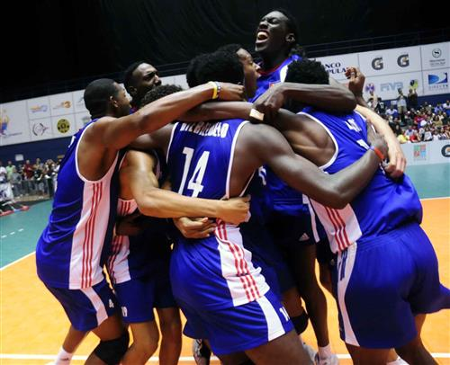 Cuban players celebrate their 14th Norceca title and the ticket to Japan